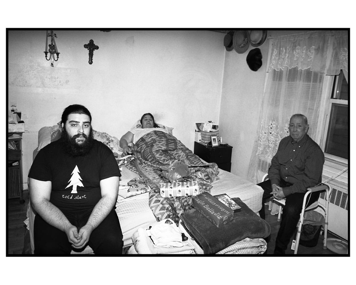 The people portrayed in this photo are Alfred (the young man with the beard), Evaristo, and Silvia. I've known this family since I arrived as a refugee to the U.S. in 1996. Evaristo was a political prisoner when he was 17 years old. He has dedicated his whole life in exile to the fight for a change in Cuba's government, a change which hasn't arrived and around which they have structured their lives, their family life as well as their social lives. Cuba has been the center of this family's life, including for Alfredo, who was born in northern New Jersey. Silvia is currently suffering from a nervous ailment and spends almost every day secluded in bed. Evaristo is the only breadwinner of the family.