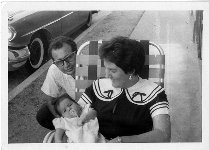 Liz as an infant in Puerto Padre, Cuba, with mom, Ada, and dad, Eduardo, just weeks before they left for their new life in Miami, 1959